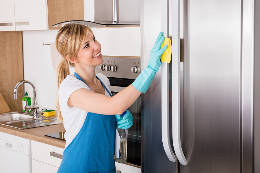 maid cleaning a refrigerator